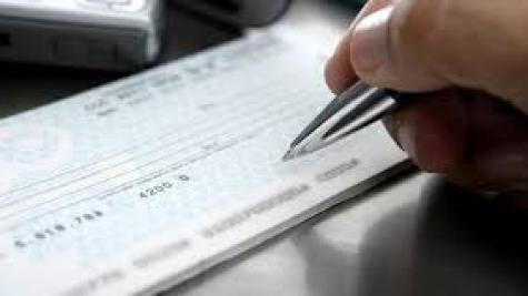 """Hoje, os cheques de até R$ 299,99 demoram dois dias úteis para """"cair"""" na conta. (Foto: Agência Brasil)"""